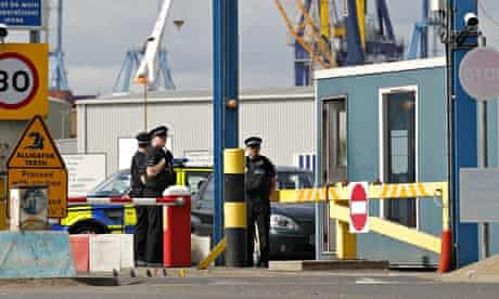 Policemen stand guard at Tilbury docks