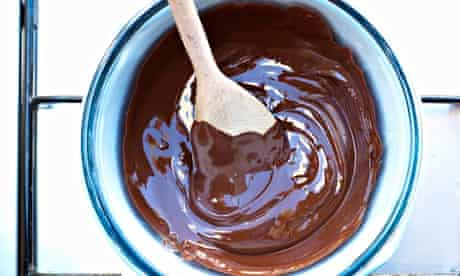 A pan of melted chocolate on cooker