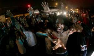 Protesters defy a curfew in Ferguson