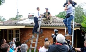 Tony Abbott as he speaks to Solahart installer Josh Staples in Canberra, Wednesday, Feb. 3, 2010