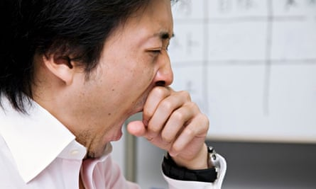 Man yawning in an office
