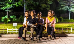 Women sit in the Kaeson Youth Park in Pyongyang, North Korea.