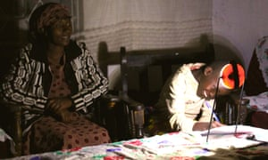 boy studies using solar-powered lamp