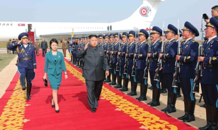 North Korean leader Kim Jong-un (3rd L) and his wife Ri Sol-ju, whose appearance is believed to be setting new fashion trends in the secretive, impoverished country.