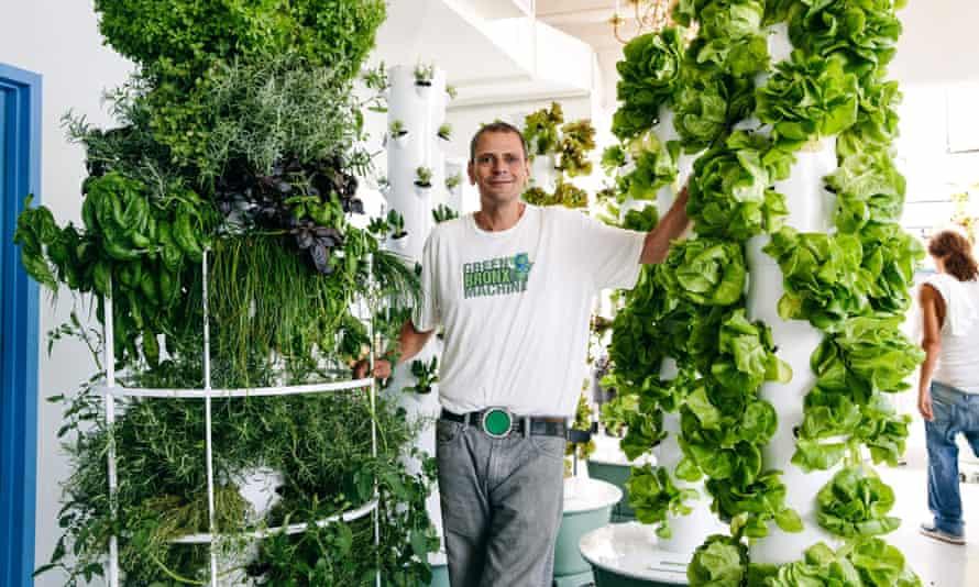 Stephen Ritz standing among vertical planters