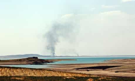 Smoke rises during air strikes targeting Islamic State militants at Mosul dam