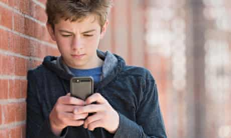 Teenage boy on phone