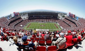 In this photo taken with a fisheye lens, fans at Levi's Stadium watch as the San Francisco 49ers play the Denver Broncos during the first half of an NFL preseason football game in Santa Clara, California.