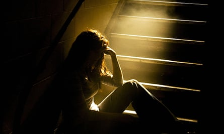 woman in dark at bottom of stairs