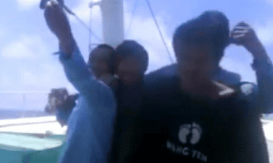 A still from the video showing what appears to be Fijian fishermen being shot and killed at sea