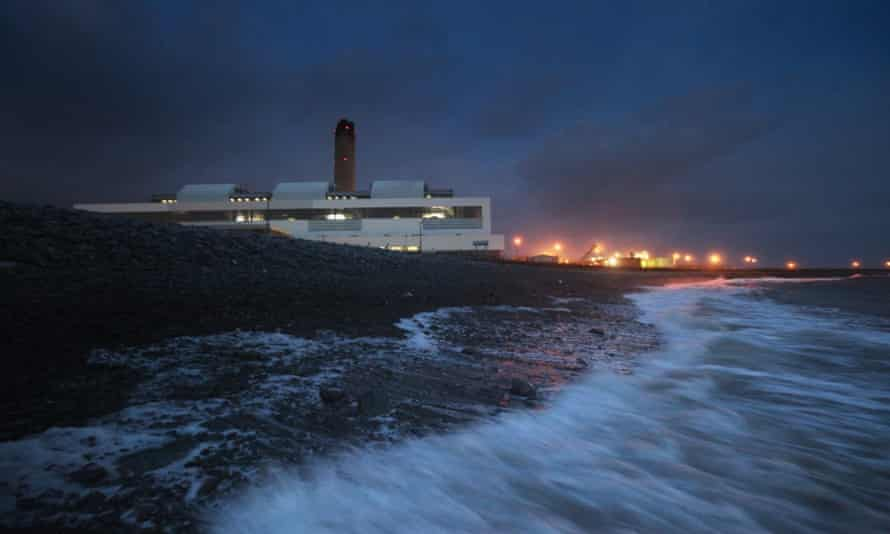 Waves crash onto the beach in front of Aberthaw power station near Barry, south Wales.