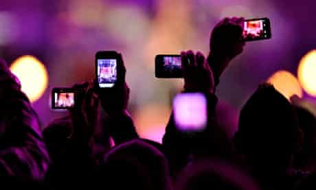 Fans take photos with their mobile phones