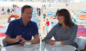 On holiday again: David Cameron and his wife Samantha pose for a photograph at the Surfside cafe on Polzeath beach, during their holiday in Cornwall.