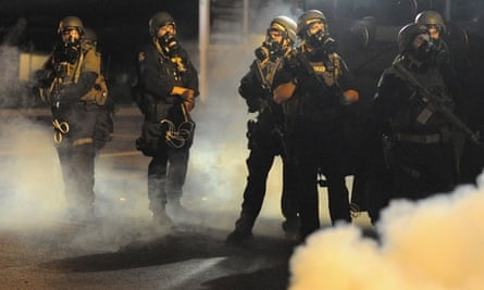 Law enforcement officers watch on during a protest on West Florissant Avenue in Ferguson, Missouri.