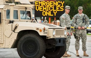 Missouri National Guard soldiers stand by at a police command post in Ferguson.