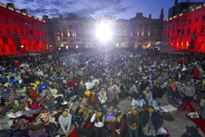 People wear E.T masks during E.T Film4 Summer Film Screening at Somerset House, London.