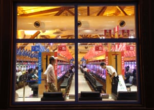 People are seen through windows at a Dynam pachinko parlour in Honjo, north of Tokyo