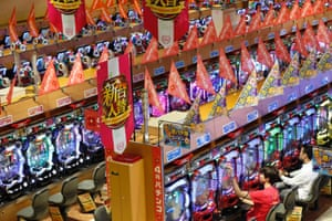 Visitors play Pachinko at a Dynam pachinko parlour in Honjo, north of Tokyo