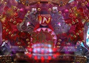 Silver balls bounce through a pachinko machine at Dynam's pachinko parlour in Fuefuki, west of Tokyo