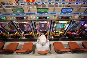 A visitor plays pachinko at Dynam's pachinko parlour in Fuefuki, west of Tokyo