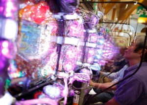 Visitors play at Dynam's pachinko parlour in Fuefuki, west of Tokyo