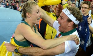 Sally Pearson celebrates after winning gold in the women's 100m hurdles final - she later unloaded on the former coach who had criticised her for missing the first day of the athlete's training camp.