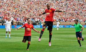 Manchester United's Ashley Young celebrates with Juan Mata after scoring their first goal.