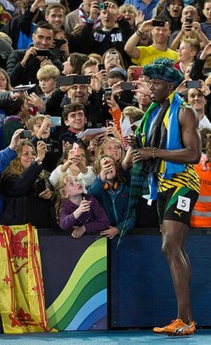 Usain Bolt by Tom Jenkins: Usain Bolt with a tartan hat