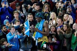 Usain Bolt by Tom Jenkins: Usain Bolt signs autographs