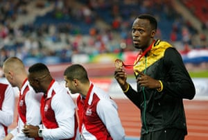 Usain Bolt by Tom Jenkins: Usain Bolt with gold medal