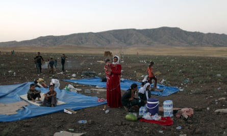 Displaced families from Iraq's Yazidi minority settle in a refugee camp.