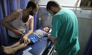 A boy is treated at al-Shifa hospital in Gaza after Israeli air strikes.