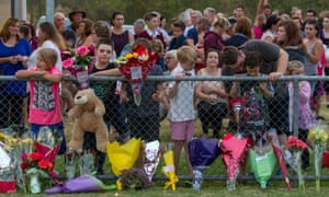 Mourners congregate at an evening vigil at Tyabb Cricket Oval in Tyabb, Victoria, where 11-year-old Luke Batty was killed by his father in February.
