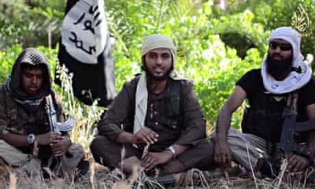 Abu Muthanna al-Yemeni, centre, believed to be Nasser Muthana,