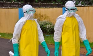 Ebola health workers wearing protective gear