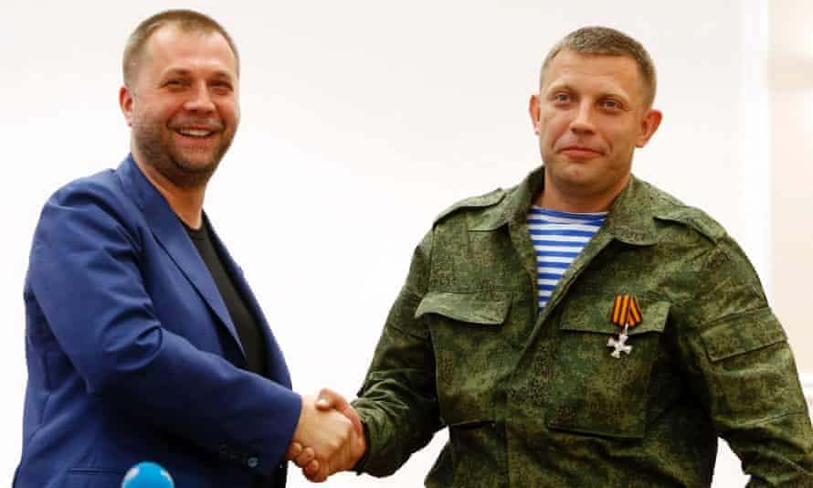 Alexander Borodai, ex-premier of the self proclaimed Donetsk People's Republic, shakes hands with Alexander Zakharchenko, who heads a the rebel unit Oplot.