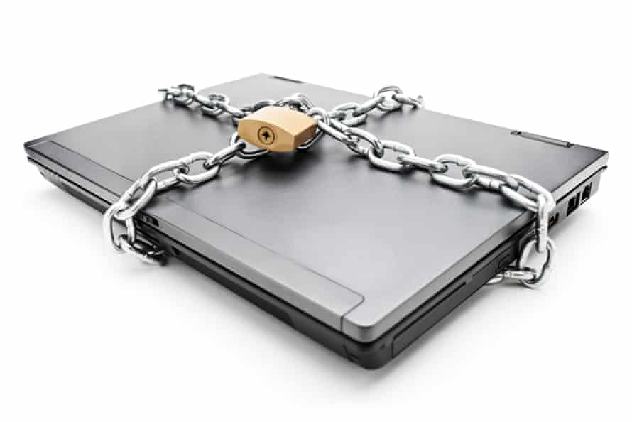 Heavy chain with a padlock around a laptop