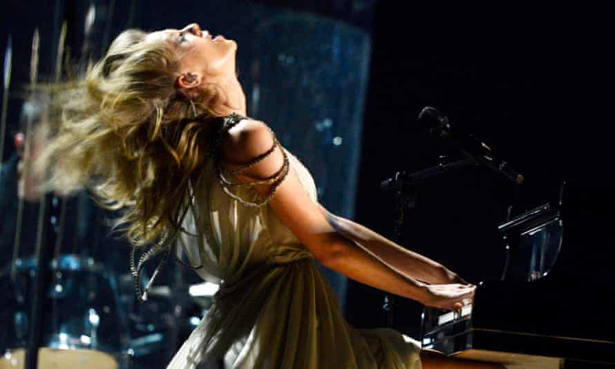 Taylor Swift performs onstage during the 56th Grammys, January 2014.