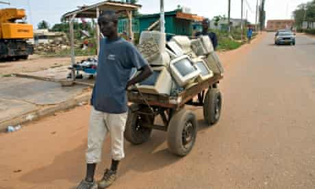 Scrap sellers pulling a cart with with computer trash, Nsawam Ghana