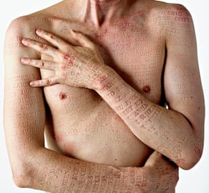 Artist Paul Emmanuel's body after servicemen's names pressed into his skin