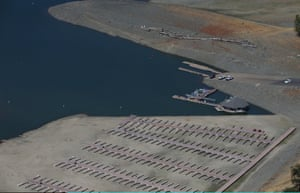 Boat docks at Browns Ravine sit on dry ground at Folsom Lake in El Dorado Hills, California. Folsom Lake is currently at 40 percent of its total capacity of 977,000 acre feet.