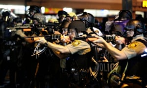 Police point guns at protesters in another example of highly militarised policing in Ferguson.