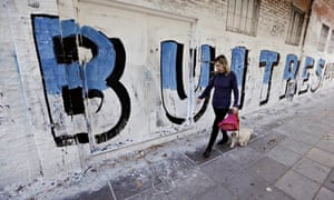 """A mural reads """"vultures"""", over the dispute between Argentina and US hedge funds, in Buenos Aires"""
