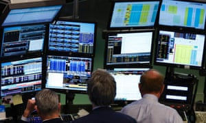Traders work at Bloomberg terminals on the floor of the New York Stock Exchange. The company now integrates environmental, social and governance data into its analytical tools for investors.