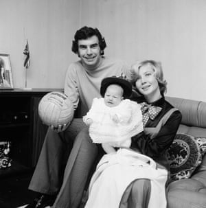 Trevor Brooking of West Ham United at home with his wife Hilkka and baby Collette, who doesn't look very happy.