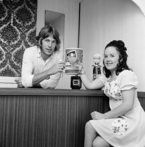 Tommy Taylor of West Ham United enjoys a drink at home with his wife Pat.
