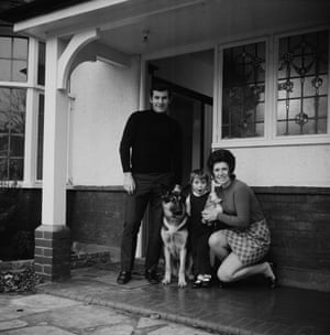 Alan Mullery of Fulham at home with wife June and his excited daughter.