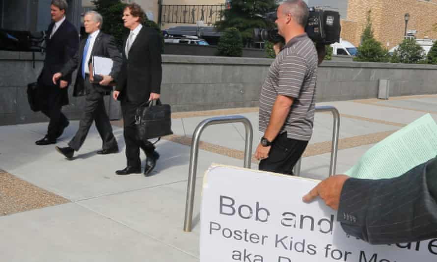 Former Virginia governor Bob McDonnell, second from left, arrives at federal court with his attorneys.