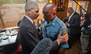 US attorney general Eric Holder greets Captain Ron Johnson of the Missouri highway patrol at a  restaurant in Ferguson