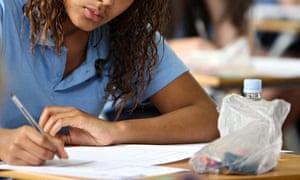 A pupil sitting her GCSE English exam